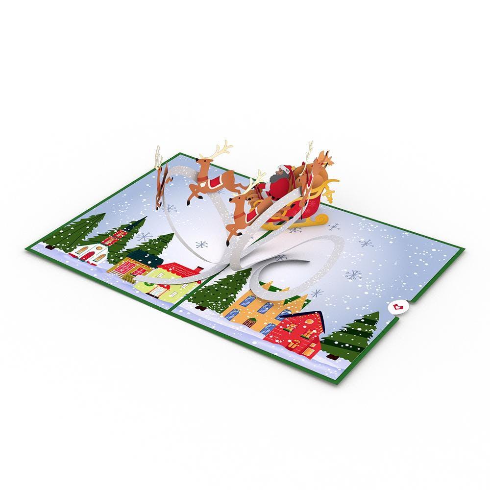 Weihnachtsschlitten und Dorf, Pop-Up Karte